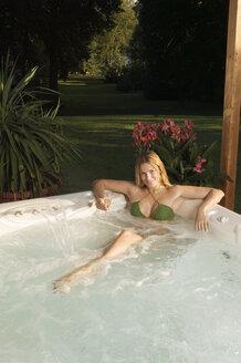 Woman in bathtub, smiling, portrait - ABF00099