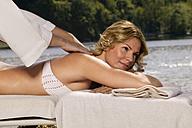 Woman getting massage - ABF00051