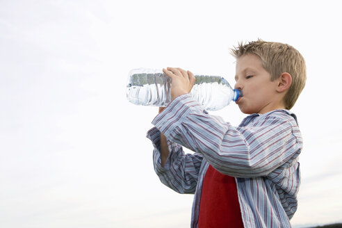 Boy (10-12) drinking from water bottle, side view - RDF00196