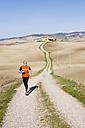 Italy, Tuscany, man jogging - MRF00730
