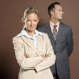 Businessman and businesswoman, portrait - JLF00262