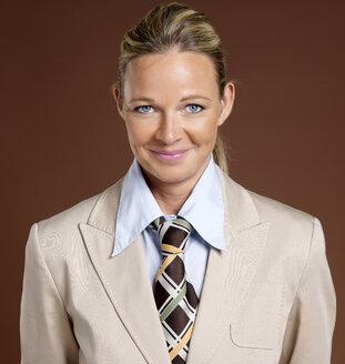 Businesswoman wearing suit and tie - JLF00253