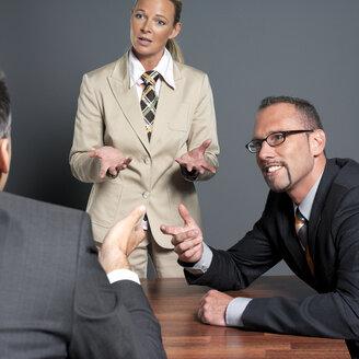 Business people having meeting - JLF00235