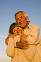Senior couple embracing, portrait - WESTF03484