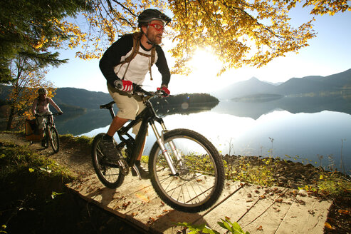 Germany, Bavaria, Couple mountain biking - MRF00798