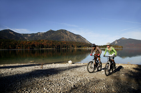 Germany, Bavaria, Couple mountain biking - MRF00792
