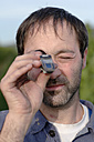 Man using refractometer - WESTF03783