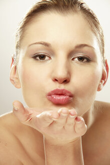 Young woman blowing kiss - LDF00430