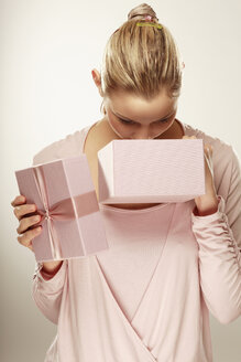 Young woman looking into gift box - LDF00421