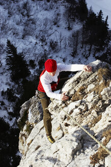 Germany, Bavaria, young woman climbing on rock - FFF00737