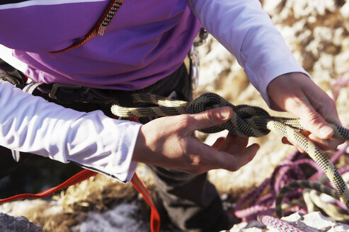 Germany, Bavaria, young woman climbing on rock, detail - FFF00731