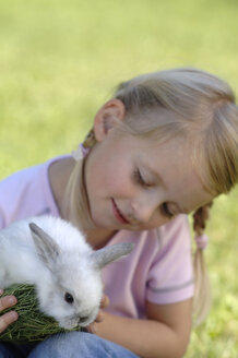 Girl holding easter bunny - CRF01085