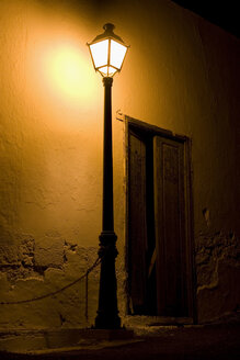 Spain, Lanzarote, lantern in front of building - ABF00141