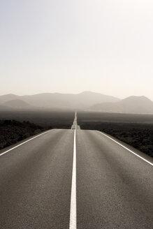 Spain, Lanzarote, empty road through landscape - ABF00135