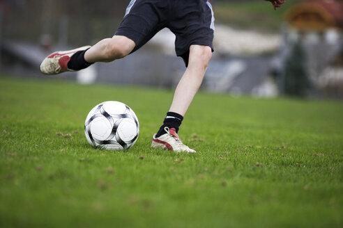 Boy (12-13), playing football - WWF00268