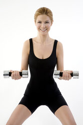 Woman exercising with dumbbells - MAEF00225