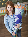 Girl holding schoolcone - WESTF04494