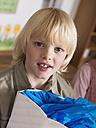 Boy (4-7) holding school cone, portrait, close-up - WESTF04479