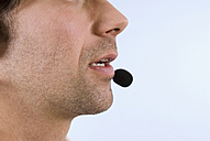 Businessman wearing headset, close-up, side view - WESTF04805