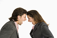 Businessman and businesswoman shouting at each other, side view - WESTF04700