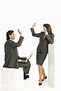 Business colleagues giving high five, smiling - WESTF04667