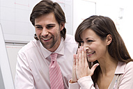 Man and woman in office, smiling, close-up - WESTF04658