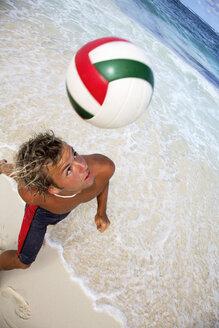 Young man kicking ball with head - PKF00015
