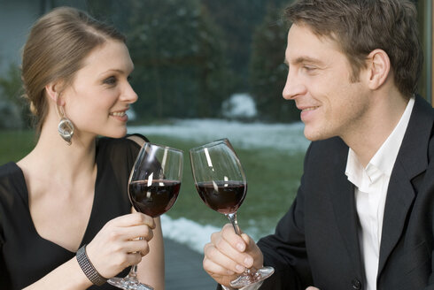 Young couple clinking glasses - NHF00501