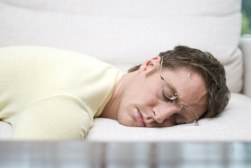 Man with spectacles sleeping peacefully - NHF00465