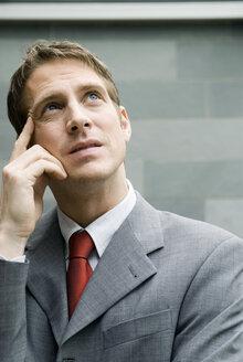 Businessman looking worried - NHF00420