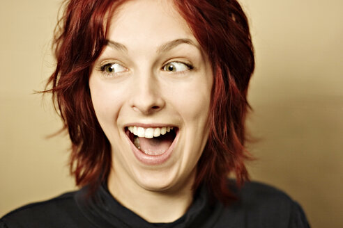 Young woman laughing, portrait - DW00083