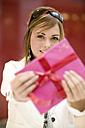 Woamn holding gift, portrait - KMF01004