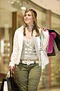 Young woman carrying shopping bags - KMF01001