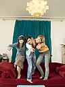 Girls dancing on sofa - KMF00945