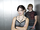 Young couple standing in lift - KMF00894
