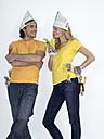 Couple with DIY- equipment leaning on wall - WESTF05202
