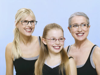 Grandmother, mother and daughter wearing spectacles, portrait - WESTF05362