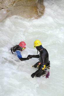 Young men body-rafting, portrait - PKF00065