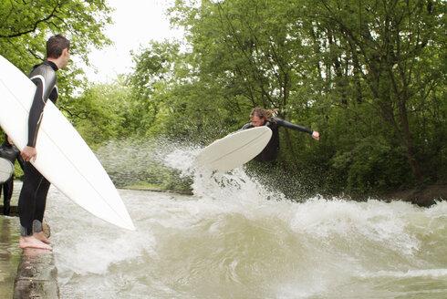 Young men surf riding - PKF00059