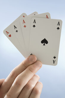 Hand holding aces, close-up - CLF00436