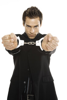 Young man with handcuffs, close-up - PKF00178