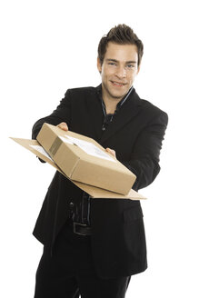 Youndg man holding packages, close-up - PKF00166