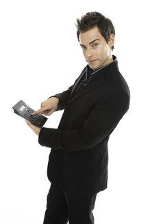Young man holding calcuator, close-up - PKF00157