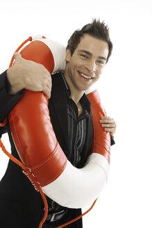 Young man carrying life belt, close-up - PKF00133