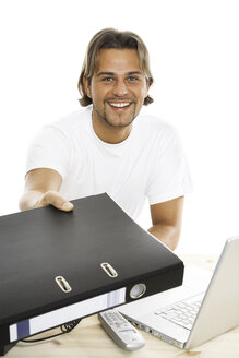 Man presenting folder, close-up - PKF00121