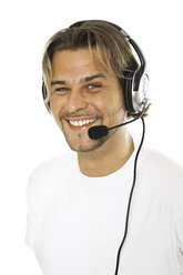 Man wearing headset, close-up - PKF00106