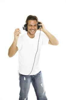 Man using headphones, portrait - PKF00103