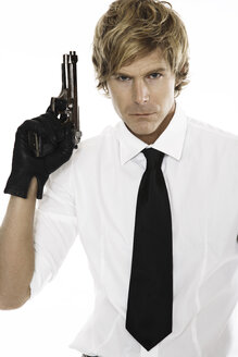 Man holding gun, close-up - PKF00085