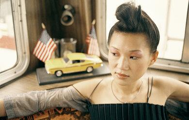 Asian woman in van, portrait - PK00229