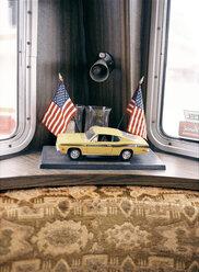 Toy car and american flaggs in van - PK00220